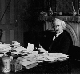 Messy desk, messy mind? Mark Twain reads his fan mail.
