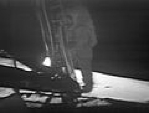 Neil Armstrong about to set foot on the moon. Image was taken from a remote control TV camera mounted on another leg of the Lunar Module