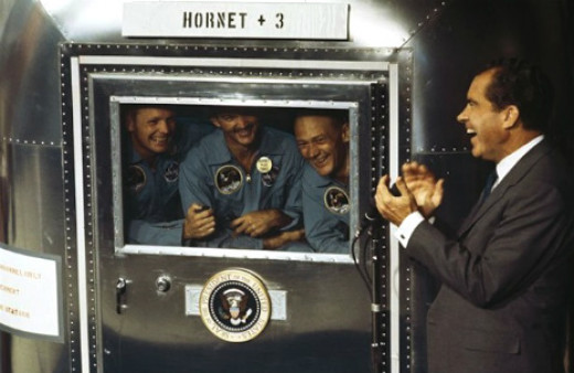 President Nixon greets the Apollo 11 astronauts aboard the USS Hornet. The astronauts were in quarantine for a few weeks to guard against space microbes.