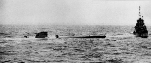 The damaged U-110, with HMS Bulldog standing by, The RN boarding team captured essential Enigma material