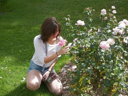 My oldest daughter Veronica enjoying the roses