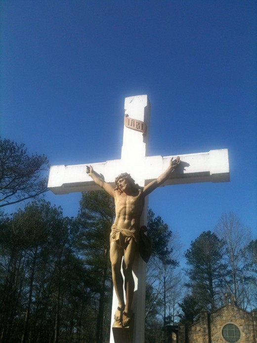 A replica of Jesus on the cross. This Crucifix is tall and towers above the graveyard. This is a peaceful place to visit.