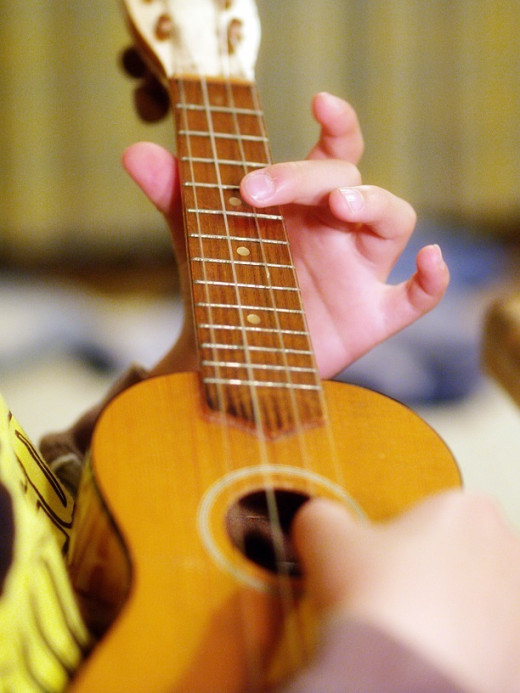 Give new life to an old ukulele by re-stringing it with new, fresh strings.