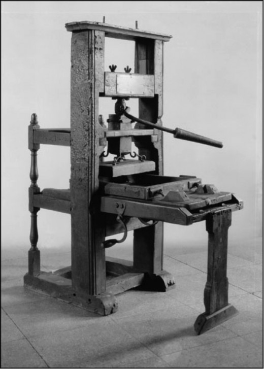 Old printing presses were operated by hand.