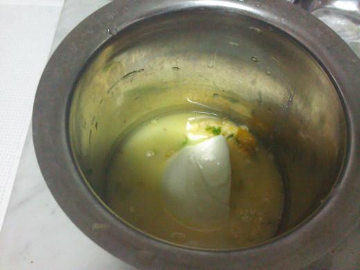 Make the batter of yogurt and gram flour