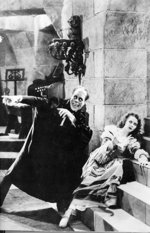 "Lon Chaney and Mary Philbin in the 1925 version of ""The Phantom of the Opera"""