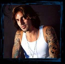 Probably the earliest poster boy for rock and roll tattoos - Tommy Lee