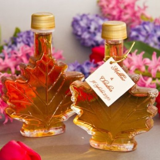Maple syrup wedding favors in lovely maple leaf shaped bottles with personalized tags