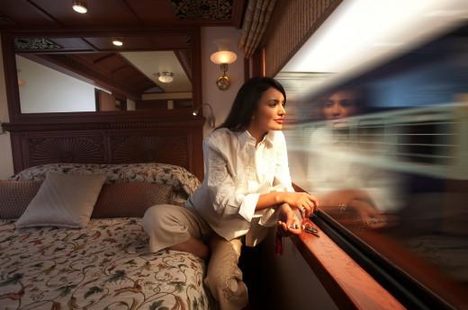 A Guest enjoying view through Panoramic Windows of Maharajas Express