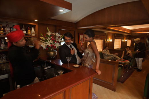 Rajah Club - Bar cum Observation Lounge with Plush seating is an ideal please for conversation or relaxation on board Maharajas' Express.