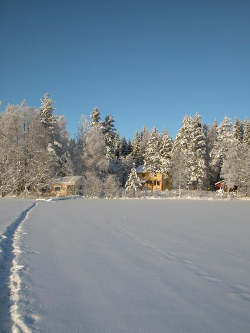 Walking Across The Frozen Lake At Mairela Retreat