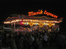 At the rodeo grounds, there is always a carnival that provides entertainment for kids of all ages.  There are also open bars, dancing areas (loud music) and food booths serving char-broiled meat (beef or mutton), fried rice, pizzas, papusas and more.