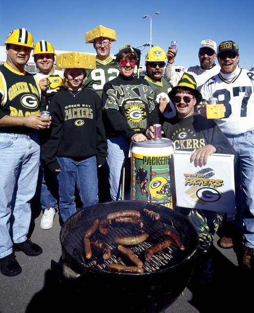 """Cheese-heads"" and other rabid fans preparing for a Green Bay Packers game"