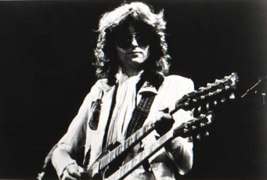 black and white guitar player. A promotional black and white image of Jimmy Page, performing with the rock