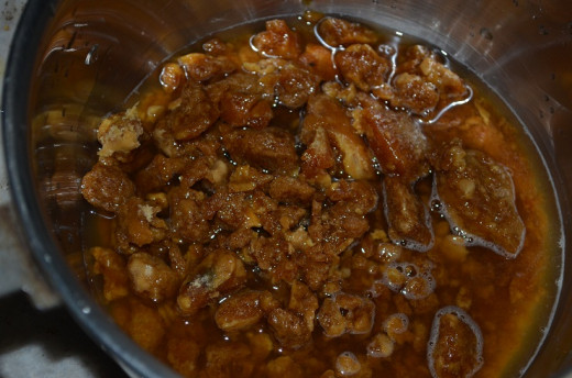 Crush the jaggery and add some water and boil the same till the jaggery gets disolved