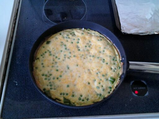 The frittata, after being baked for 10 minute,s is done. Let it stand for 5 minutes before removing it from the pan.