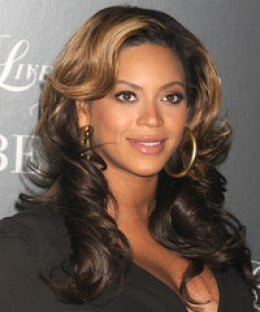 Beyonce with long wavy tresses.