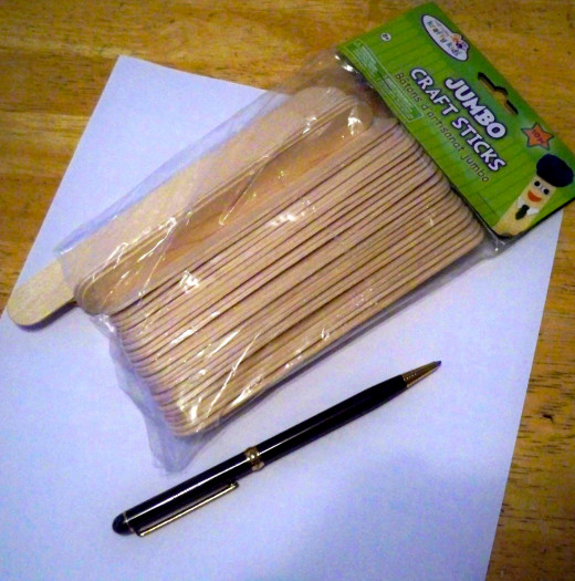 Paper for making patterns, pen, and craft sticks round out your supply list.
