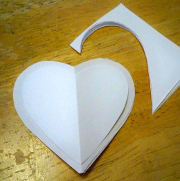 From the eighths cut patterns for a front and back piece (in this case two hearts), one smaller than the other.
