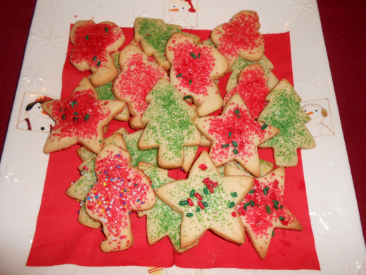 Christmas cookies in the shape of Santas, stars and Christmas trees.