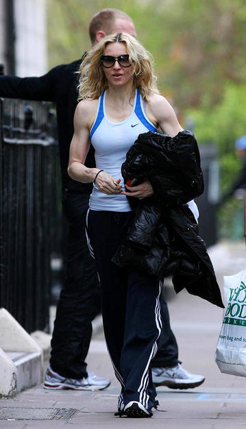 "Madonna obviously works out a lot to get buff arms like that! When the ""Material Girl"" called London home, she reportedly bought the house next door to her family's residence and turned the entire place into a gym."