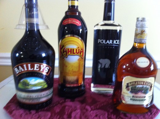 Four of our favorite bottles to have on hand.; Baileys Irish Cream, Kahlua, Vodka and Appleton Estate Jamaica Rum.