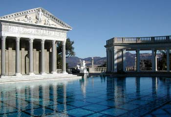 The world's most photographed / most famous pool This is the pool of Hearst Castle in California. The impressive outdoor pool of Hearst castle is built like a roman temple. William Randolph Hearst resided here in the early 1900s.