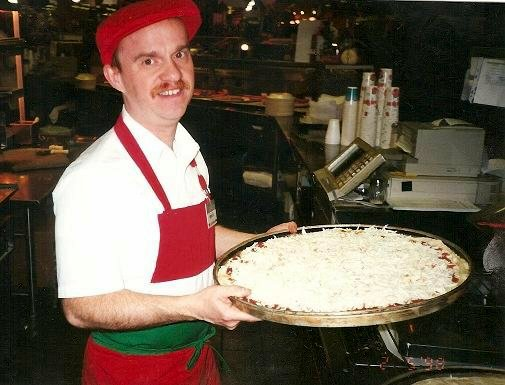 This is a photo of me at work, making gourmet pizza at a former employer.  This is a job I had for over 8 years, and I learned how to make many different kinds of pizza. I was told by many of my customers that I made the best pizzas they ever had!