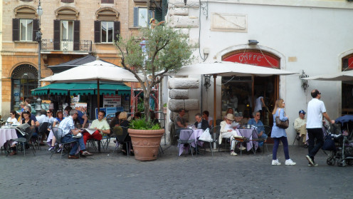 Italians know how to start the day in bright mood with a creamy latté at a local café