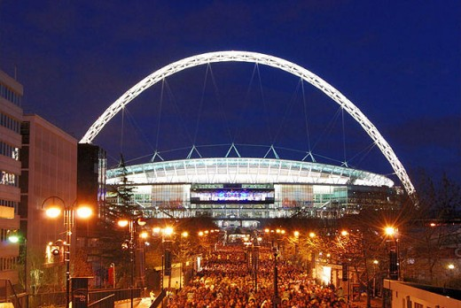 The great Wembley Arch illuminated for an evening event.