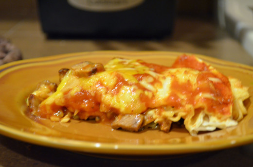 Slice into a wedge of layered beef enchilada, a quick and easy dinnertime recipe.