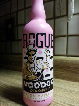 Distinctive pink bottle of Rogue Voodoo Doughnut Bacon Maple Ale