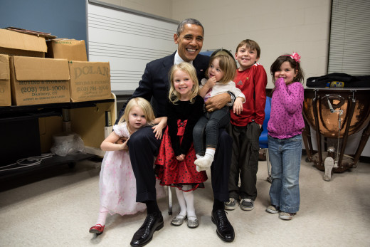 Obama with the family of Emily Parker