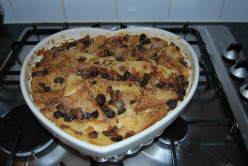 Why should the crusts of the bread be removed when making a bread and butter pudding?
