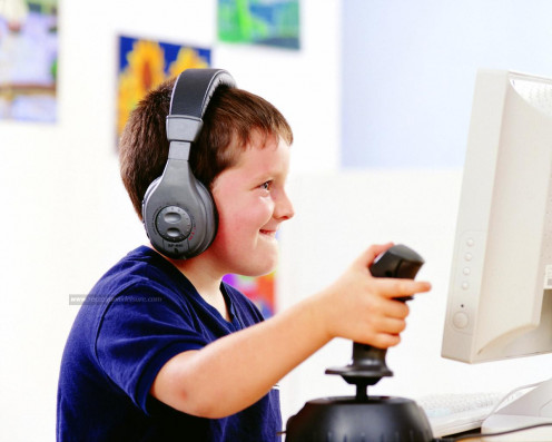 A kid playing on a PC.