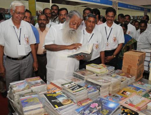Writer Balakumaran visiting the stalls in the fair