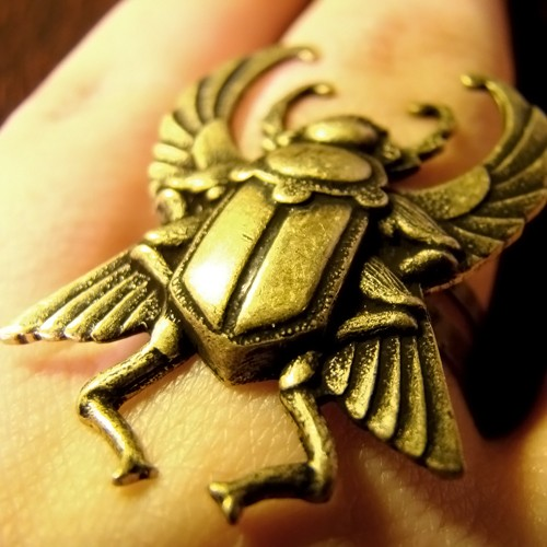 An Egyptian scarab ring, shown with wings spread.  Some dung beetles do fly.
