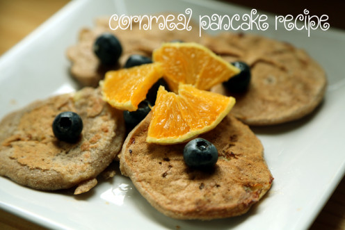 Cornmeal pancakes with blueberries and orange