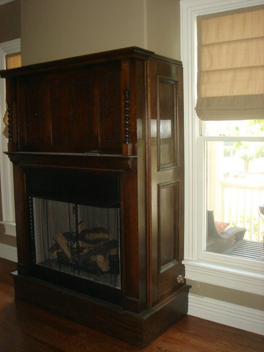 AFTER Side view detail showing wall that was bumped out and side panels added and stained to match the antique mantle.