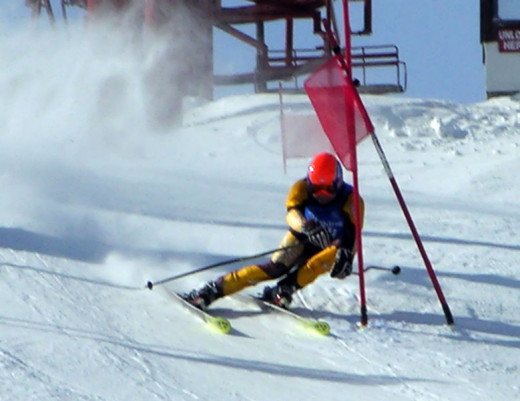 A skier racing downhill