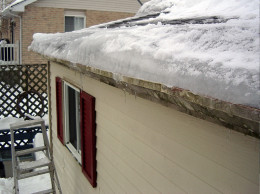 A view of the ice dam which is preventing the melted snow from flowing off the roof.