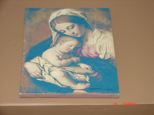 This is a picture of Mary The Mother of Jesus.  It is also hanging in the living room.  It is is hanging over the doorway.