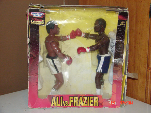 These dolls were purchased for me in the 90's.  They are of Ali and Frazier and they have real terry cloth robes.