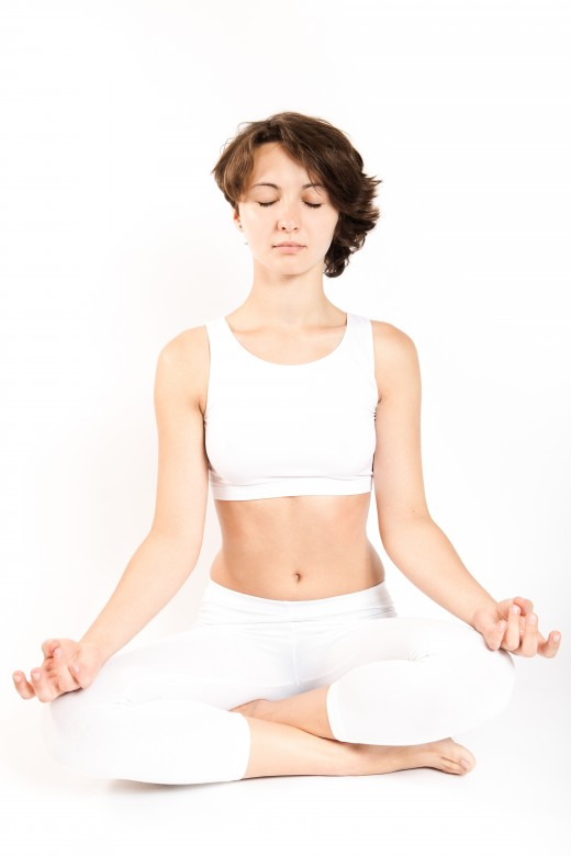 A girl in the lotus position, practicing yoga