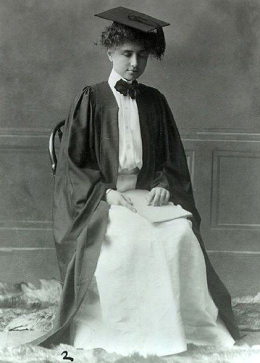 Helen graduating from college.  Annie had spelled all Helen's  courses into her hand.  Helen is reading the document in her lap, which is written in Braille.  Braille is a series of coded raised dots, which one reads by touch.