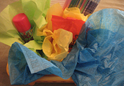 Begin layering tissue and gift items