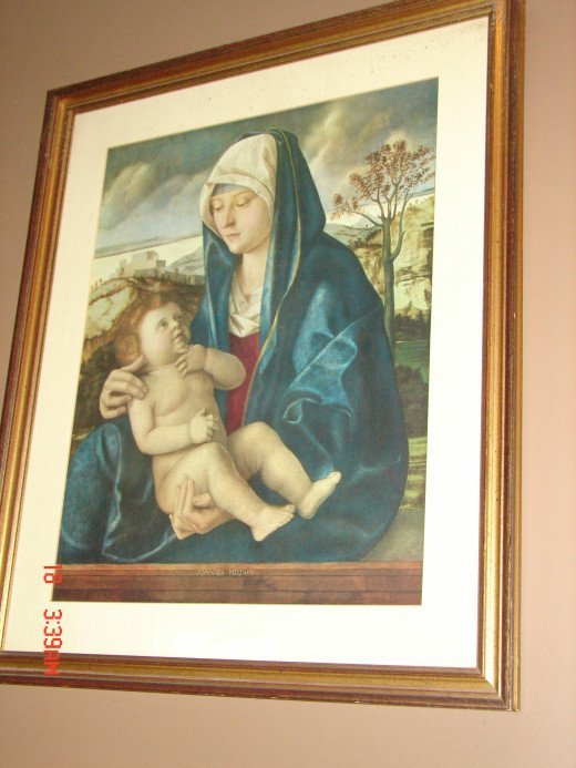 This picture can be found in my living room.  I love it.  It depicts Mary's love for her son Jesus. It's a big framed picture that I simply adore.