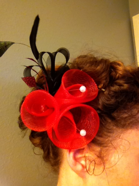 """This hairstyle works well with smaller fascinators because your hair gives the fascinator a """"nest""""."""