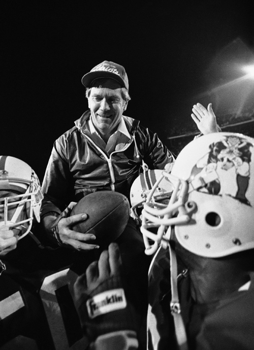Head Coach Raymond Berry is carried off the field after the victory over the Dolphins in the 1985 AFC Championship Game