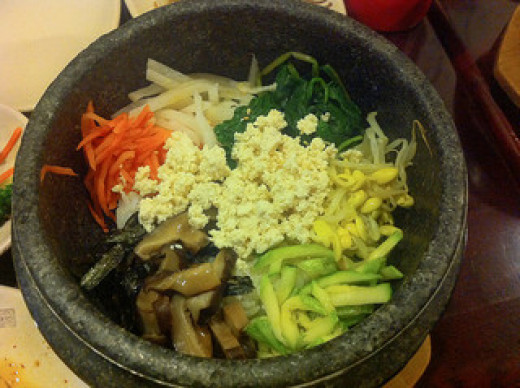 A bibimbap dish made with vegetables and tofu